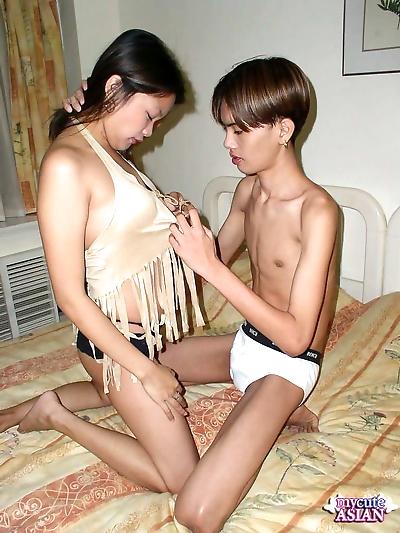 Asian couple undress each..