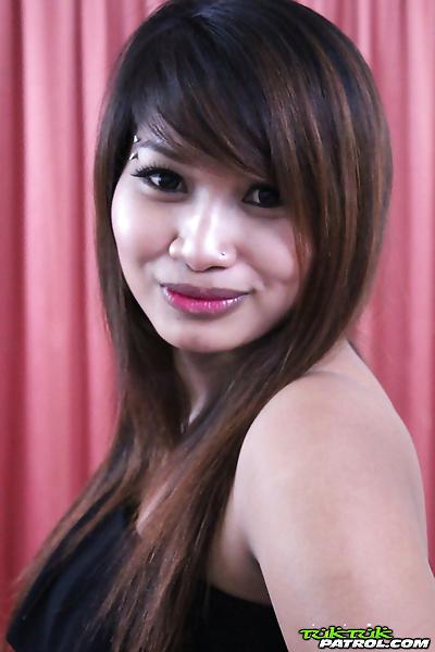 Chubby Thai girl strips off..