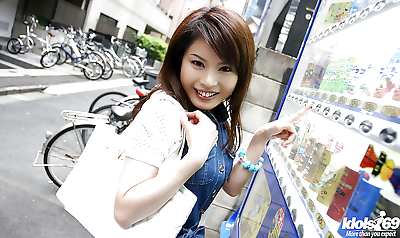 Pretty asian babe gives a..
