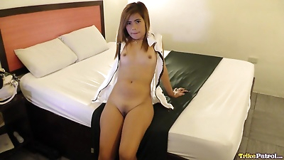 Petite Filipina girl with..