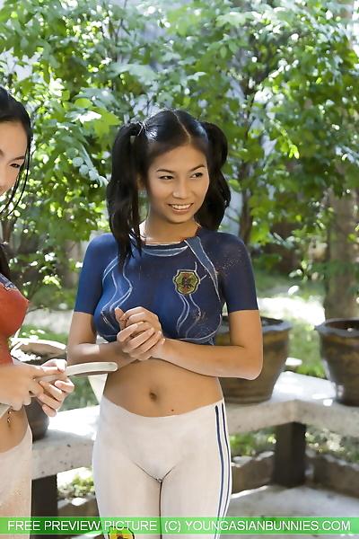 Young Asian lesbians wash..