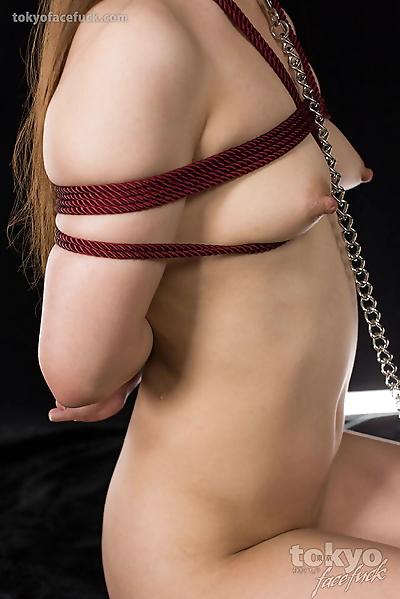 Restrained Japanese girl..