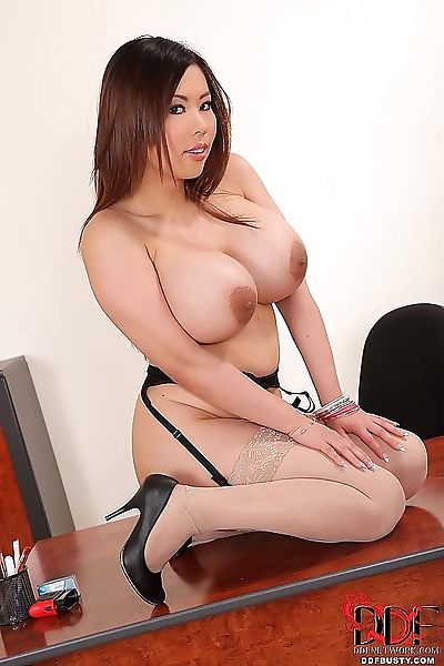 Asian babe Tigerr Benson freeing massive knockers in nylons and high heels