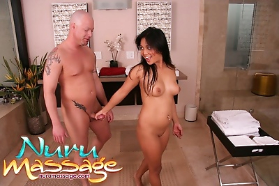 Foxy masseuse has some oily fun with her client and gets jizzed over her pubis