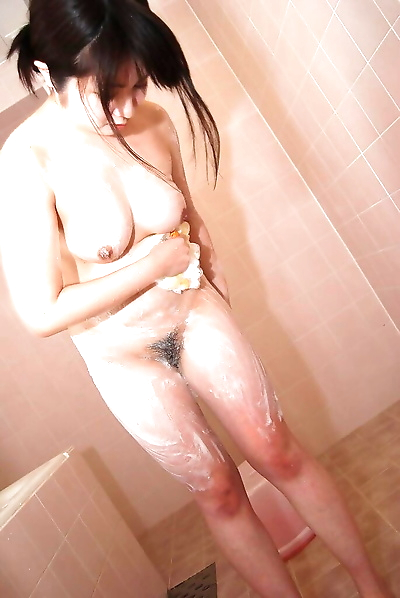 Cute Momo is a stunning brunette babe with cute tits in bath