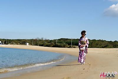 Asian model Chiaki strolls along the beach and surrounding area in a kimono